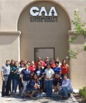 CAA staff celebrate their favorite teams at annual training.